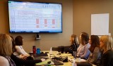 Group of cancer care providers reviewing patient caseload statistics
