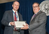 Jürgen Unützer, MD, MPH, MA accepts the APA Certificate of Significant Achievement for BHIP
